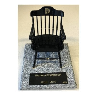 A miniature captain's chair on a granite base