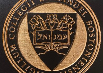 Gold Emmanuel College Seal on black background
